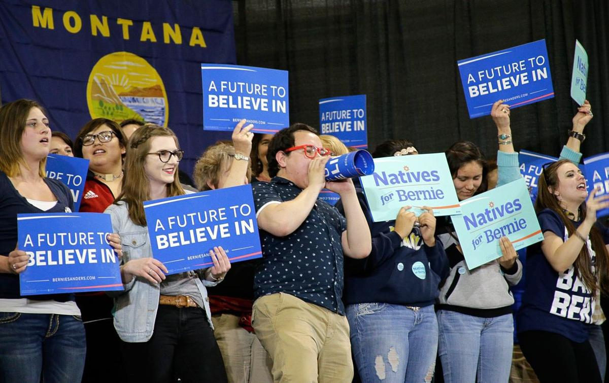 Supporters cheer for Bernie Sanders