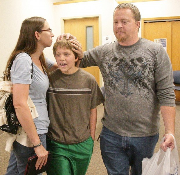 Rob, Tana and their son Damian Wilkerson prepare to leave the Shriners Hospitals screening clinic