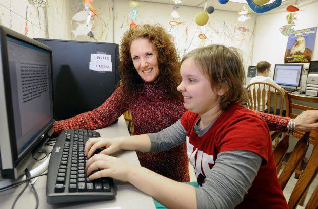 Margo Haak works with student Rylie Kaiser