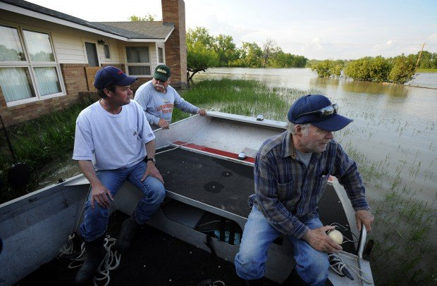 Joe Horn drags his air boat to Ken Brown's home along the Milk R