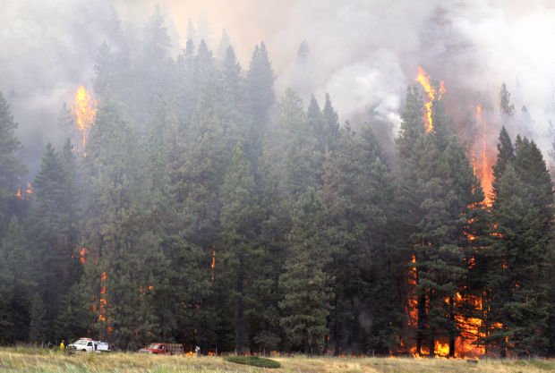 Firefighters work to control the Firestone Flats fire near Arlee