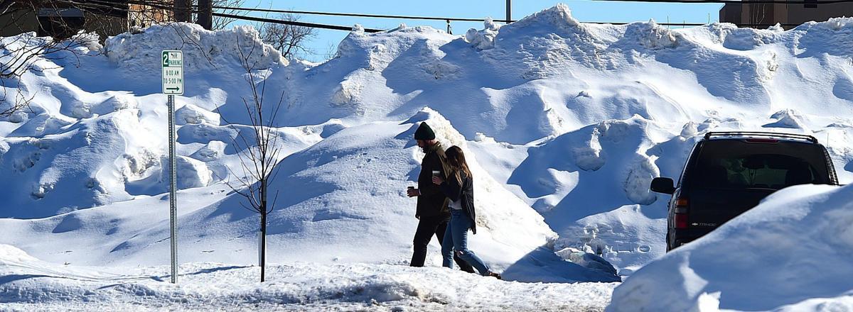 Downtown snow piles