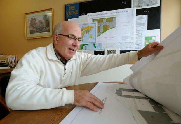 Sam Rankin looks over construction plans