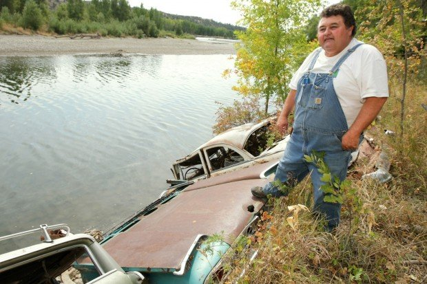 Rick Limpp looks over a row of old cars