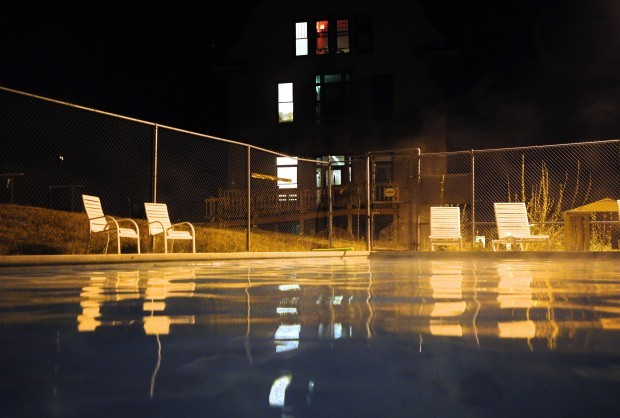 Steam rises from the warm pool outside the hotel portion of the Boulder Hot Springs.
