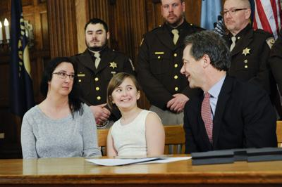 Gov. Steve Bullock, right, speaks with Jodi Moore, left, and Branna Moore,
