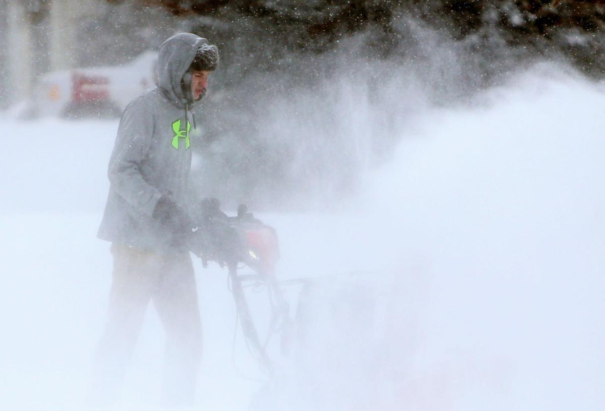 Taylor Whittle snowblows his driveway