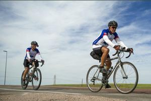 Pair pedal through Gillette, raising money for research