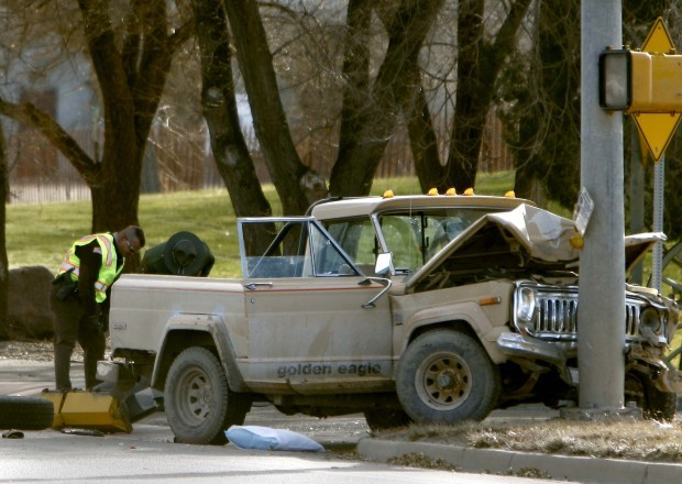 Police investigate the scene of an accident