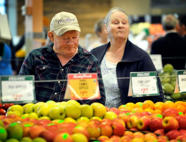 Shoppers look over produce