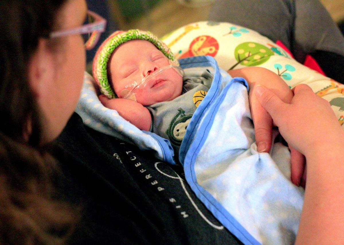 Briona Ferguson of Billings holds her son Eason