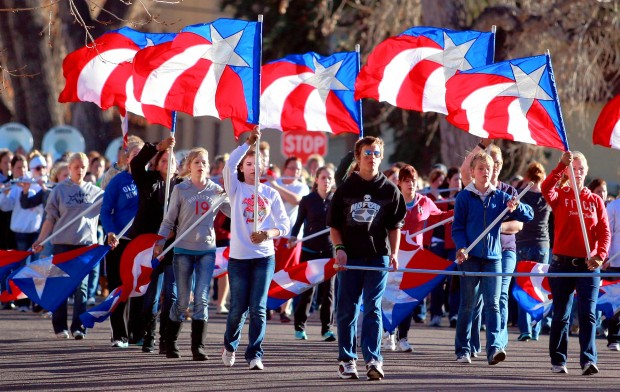 73e947e7e29 Color guard members lead the Wyoming All-State Marching Band during  rehearsal Sunday in Cheyenne. The band will perform during the Macy s  Thanksgiving Day ...
