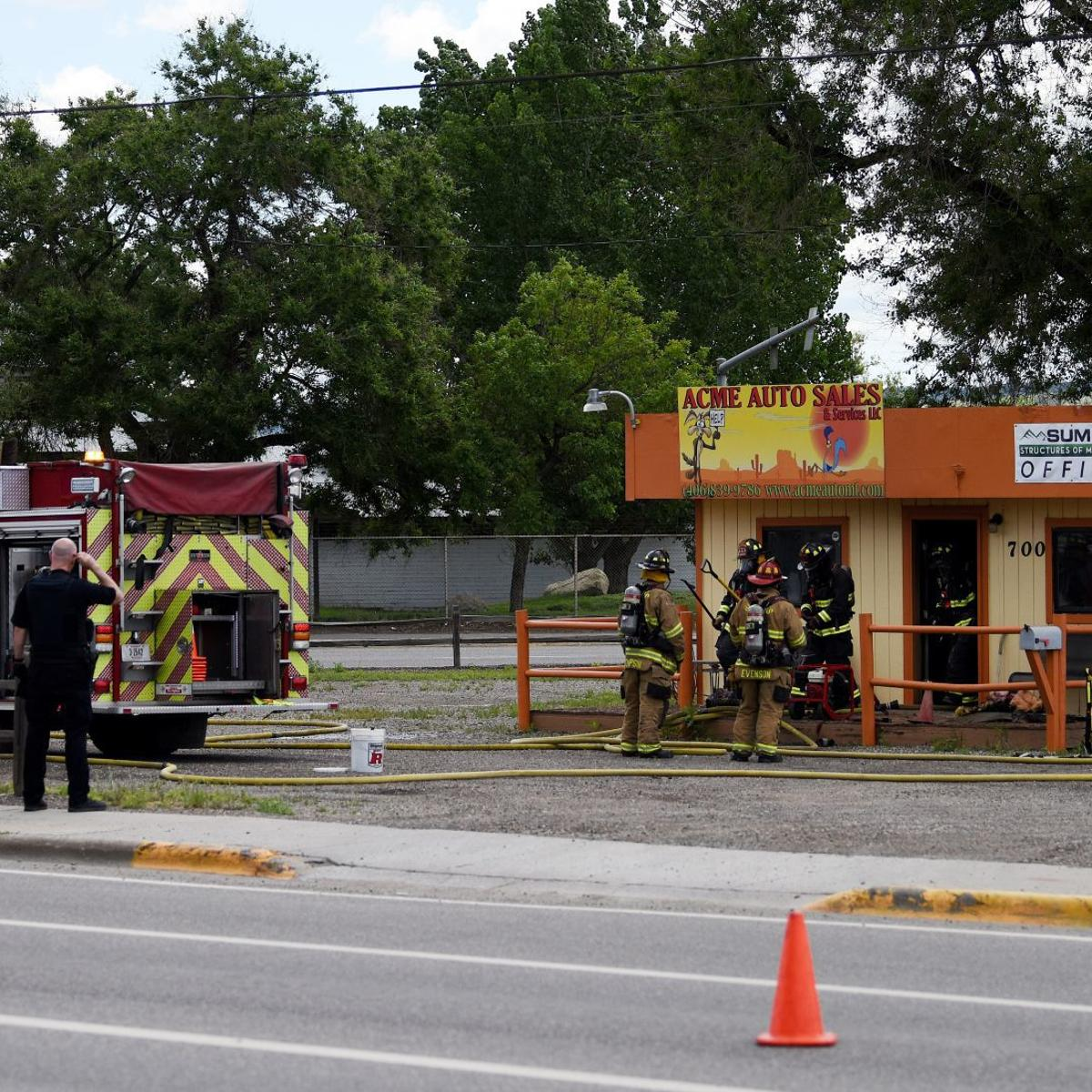 Sunday morning fire at Acme Auto Sales & Services remains