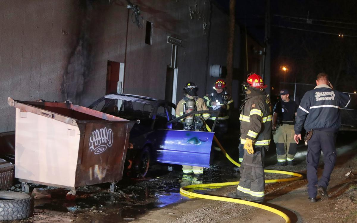 Vehicle fire in alley