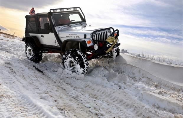 Mark Cardwell climbs a drift in his Jeep
