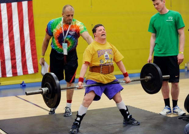 Special Olympics athlete Glenn Roach from Great Falls strains