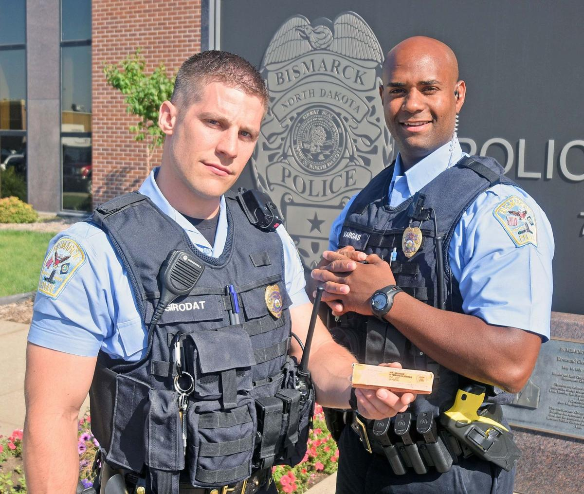 Police Officers Damian Girodat, left, and Melvin Vargas