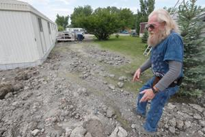 Trailer park residents frustrated after 'river' of mud and trash flows out of Billings landfill