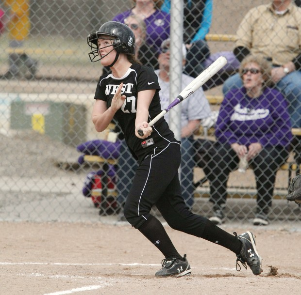 Taylor Huebner of Billings West watches her three-run home run