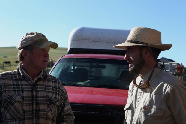 Bighole Valley Rancher Blake Huntley, left, talks with Steve Primm