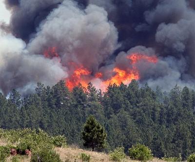 Flames errupt on a ridgeline