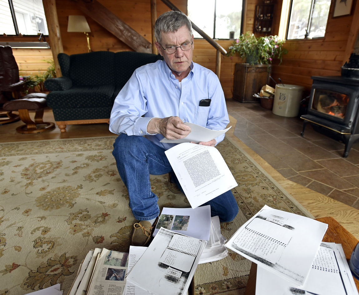 Jerry Burns looks through a box of papers