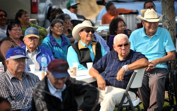 Crow elders listen to speakers during a ceremony in Pryor