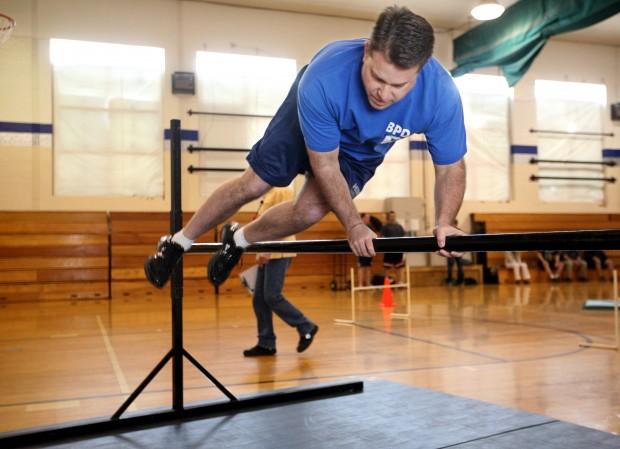 Ken Paharik jumps over a fence obstacle