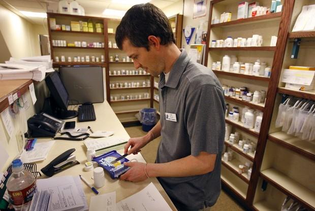 Pharmacist Joel Nicholls fills a prescription