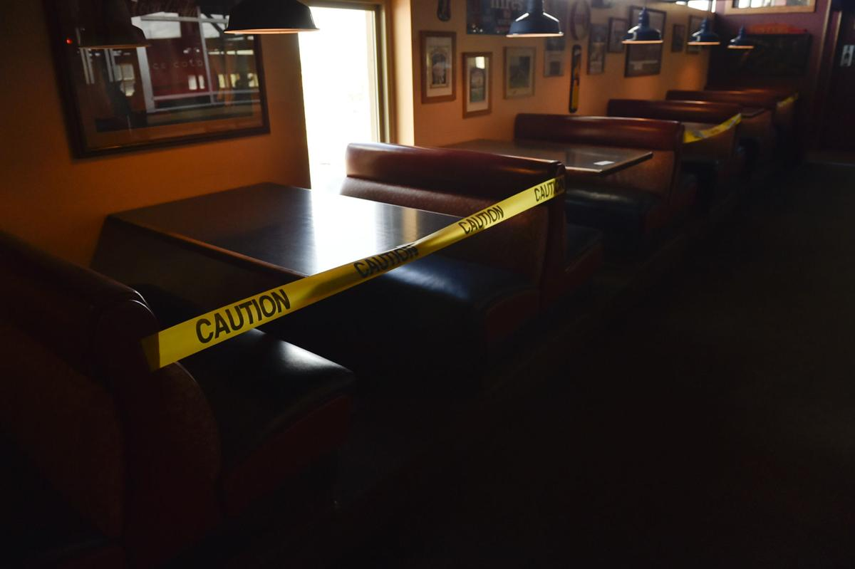 Every other booth in Brewhouse is marked off with caution tape to maintain proper social distancing between tables.