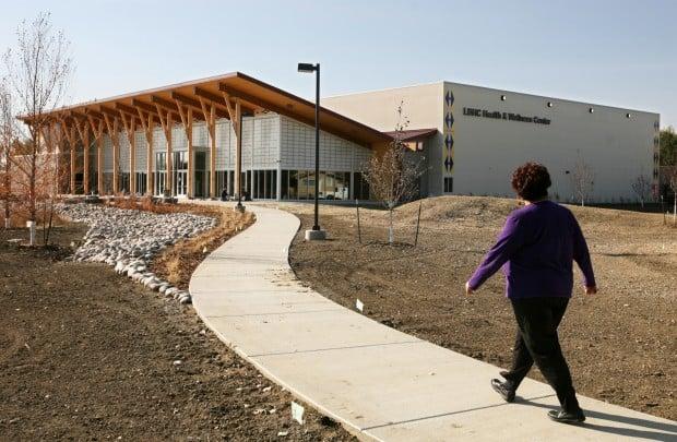 Melodee Reed walks toward the new Health & Wellness Center