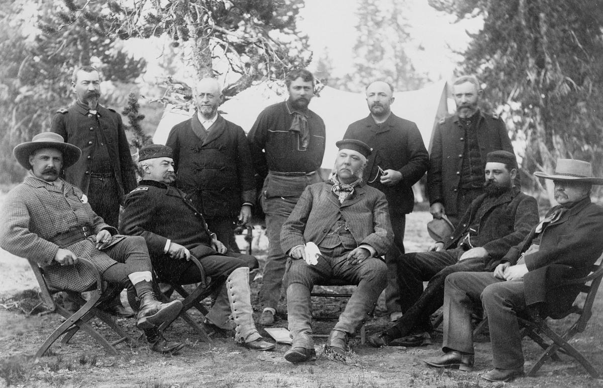 F. Jay Haynes composed this photo of President Chester Arthur, seated in  the center, and his guides during an 1883 trip to Yellowstone National Park.