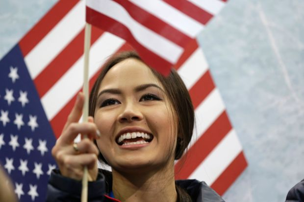 Madison Chock of the United States cheers
