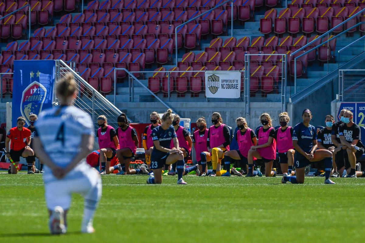 Players from the North Carolina Courage and Portland Thorns FC knee out of respect for the Black Lives Matter movement during the first round of the NWSL Challenge Cup at Zions Bank Stadium in Herriman, Utah, on Saturday, June 27, 2020.