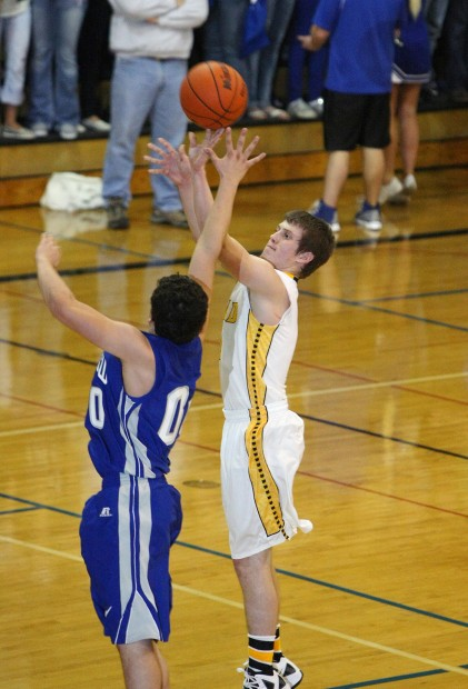 Clay Compton of Billings West shoots a three