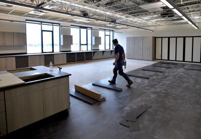 Workers lay flooring