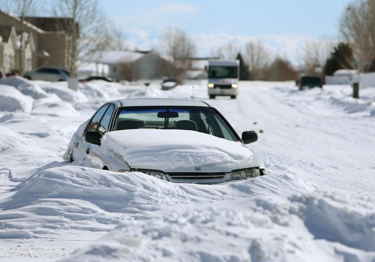 A car is buried in the snow