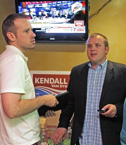 Aaron Browning, left, and Kendall Van Dyk  check election results