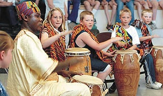 Ghanaian teaches Rose Park students how to drum