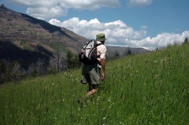 Chuck Neal crosses a green grassy field