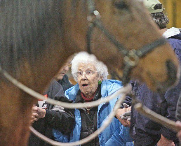 Gladys McLarnon gets ready to mount Jessy James