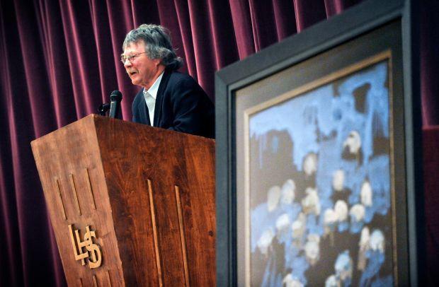 Artist Ted Waddell speaks students in the Laurel High School