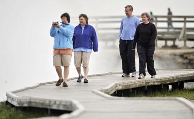 Tourists walk along the boardwalks in Yellowstone Park