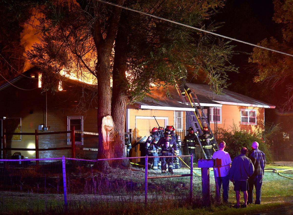 Firefighters battle a house fire on Wicks Lane