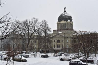 Snow falls on the Montana State Capitol