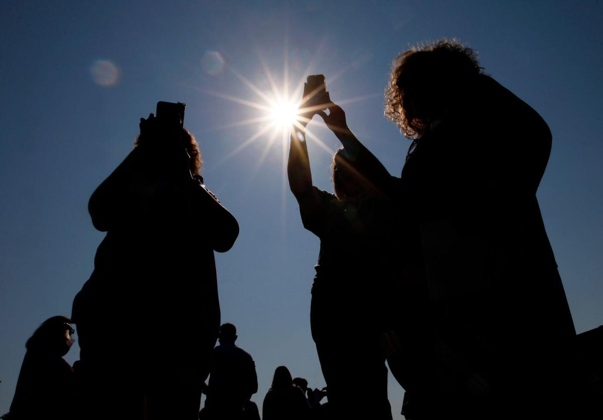 Phoning in the eclipse