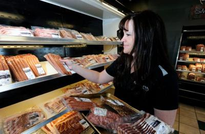 Tanya Flowers works in the Ranch House Meat Co. store.