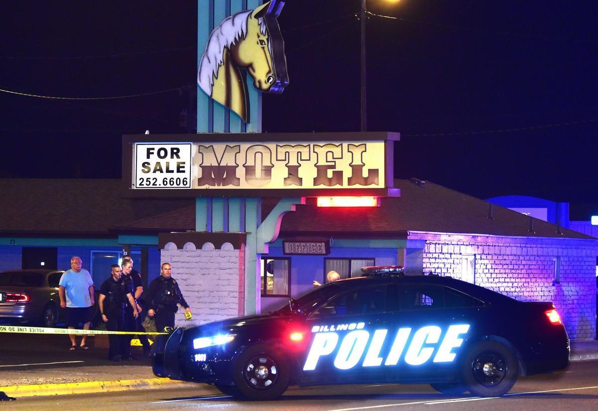 Shooting motel sign