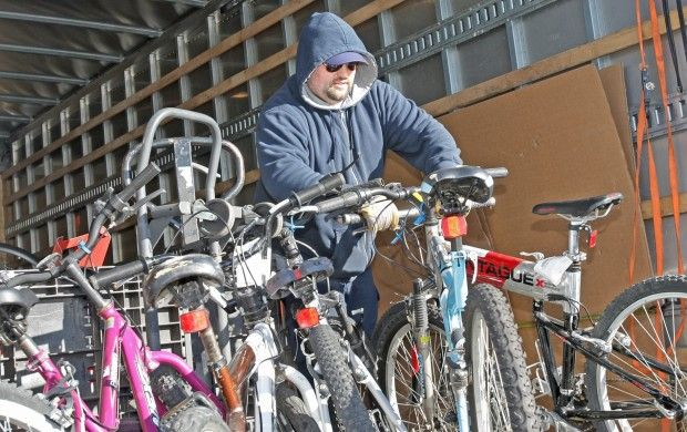 Josh Hyneman loads bicycles