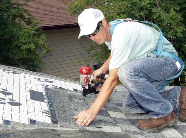 Matt Ferguson shingles a roof